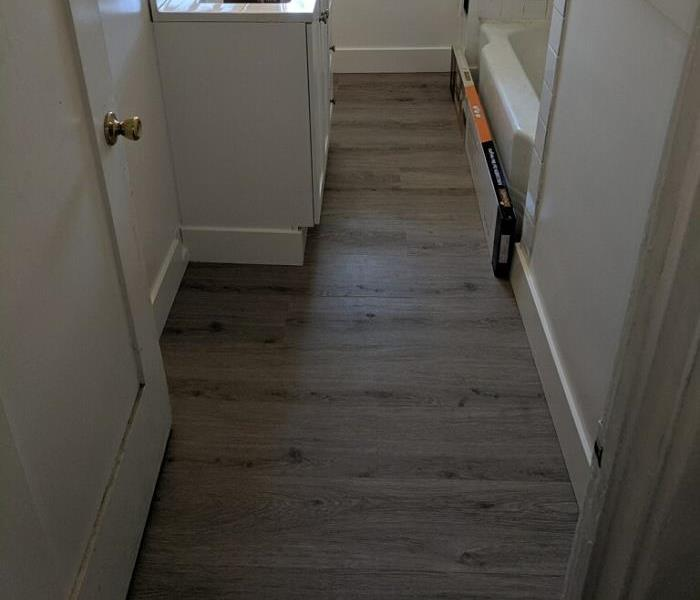 New Flooring and Drywall repairs completed