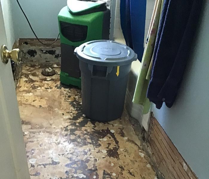 Flooring ripped out of bathroom due to water damage