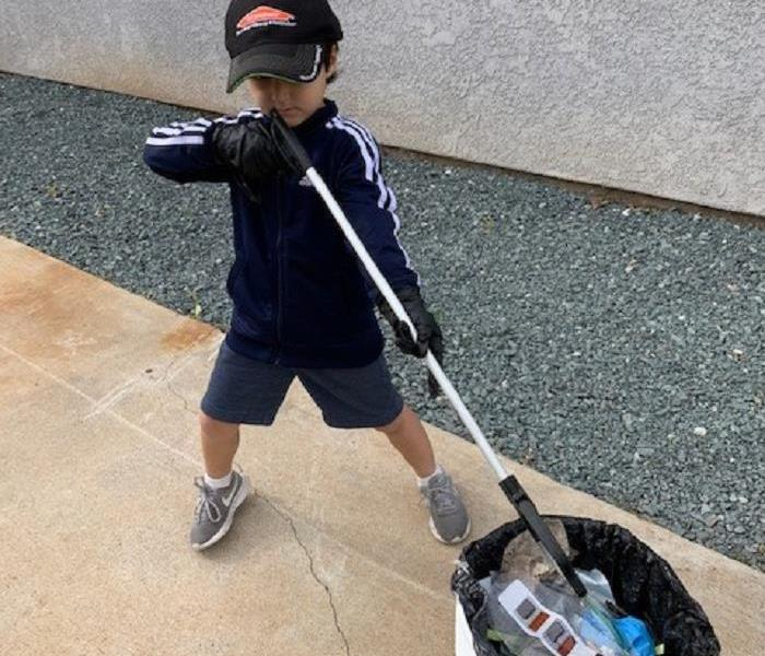 Six Year Old helping with trash pickup