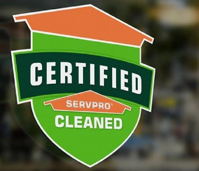 Certified: SERVPRO Cleaned sign on window
