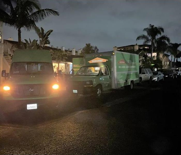 SERVPRO truck outside a home at night