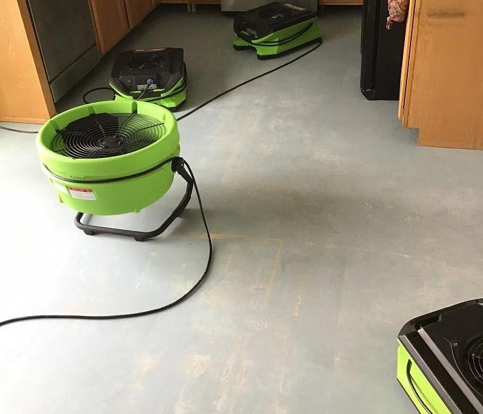 Kitchen being dried after a slab leak