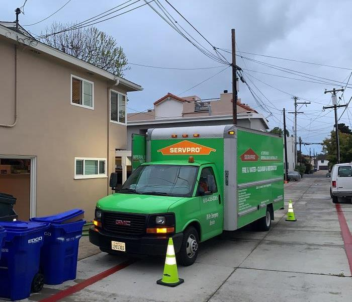 SERVPRO Van in an alley