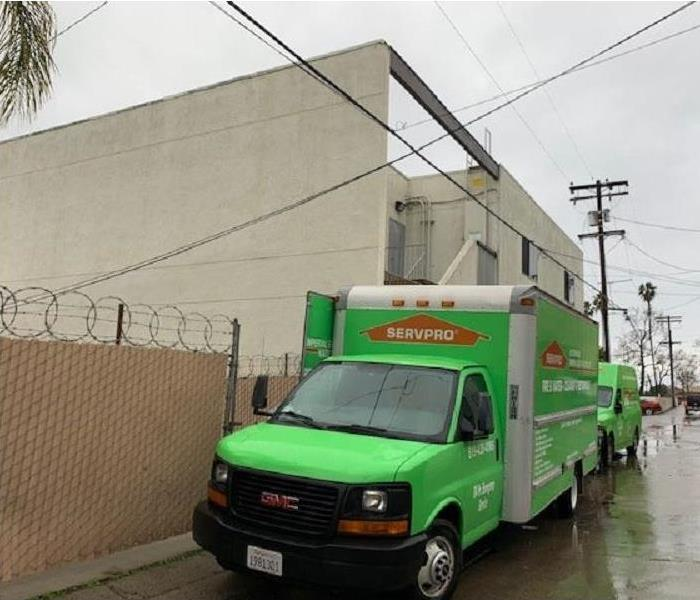 Servpro truck in an alley parked in the rain